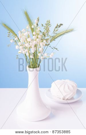 Lilies in a white vase and a zephyr