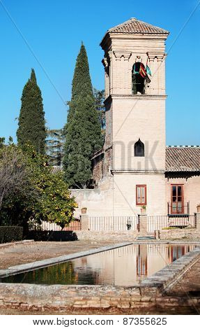 GRANADA, SPAIN - JANUARY 5, 2013: View to 4 stars Parador hotel in Alhambra. The building is a former monastery built on the orders of the Catholic Monarchs on the site of a Nasrid palace