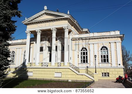 ODESSA, UKRAINE - MARCH 23, 2015: People near the Archaeological museum. Founded in 1825, it is one of the oldest museums in Ukraine