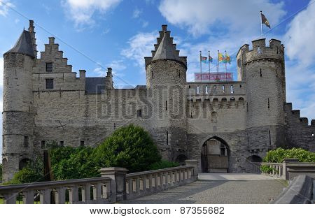 ANTWERP, BELGIUM - JUNE 23, 2013: People near the Steen castle in a summer day. Het Steen is the oldest building of the city and used to be its oldest urban centre