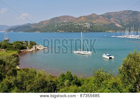 MARMARIS, TURKEY - APRIL 3, 2014: Yachts anchored in the bay. Marmaris yacht marina is among the biggest in Turkey with spaces for 650 boats on pontoon berths and over 1000 spaces on the hard standing