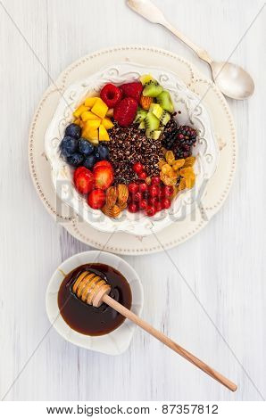 Honey black quinoa with fruits,berries and nut for breakfast