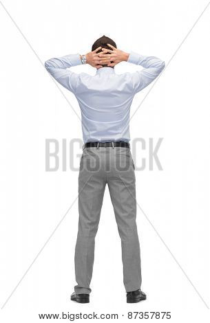 business, people, rear view and office concept - businessman with hands behind his head from back