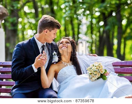 Groom embrace  bride with flower summer  outdoor.