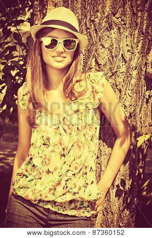 Attractive young woman with beautiful smile outdoors. Fashion. Summer day.