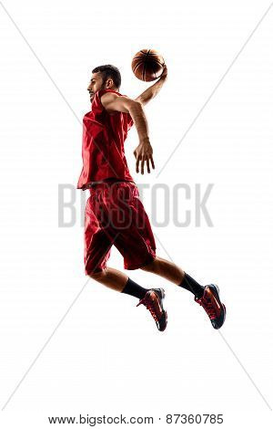 Isolated basketball player in action is flying high