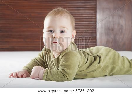 Cute Baby On Bed Looking