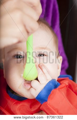Eating Green Plastic Spoon