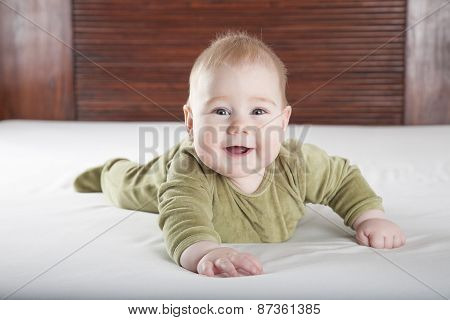 Green Onesie Baby Looking At Camera