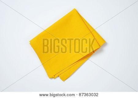yellow place mat on white background