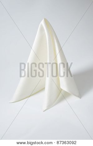 white folded napkin on white background