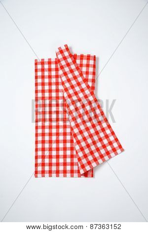 red and white checkered napkin on white background