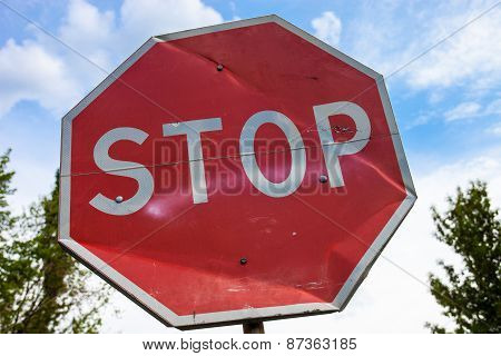 Stop Sign With Partly Bent Surface