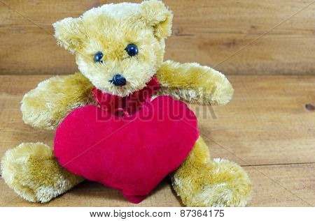 Brown Teddy Bear Hugging A Big Red Heart