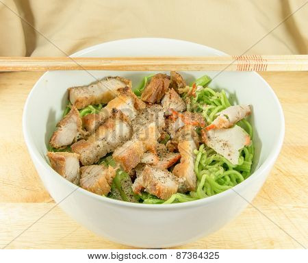 Asian Style Red Pork And Fried Pork Noodles