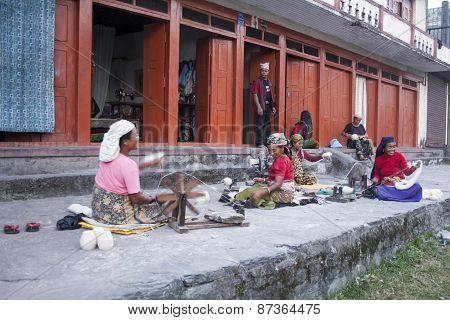 Woman Spinning Wool