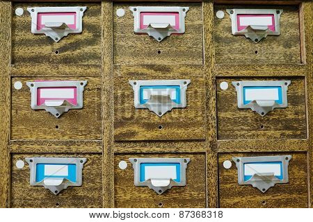 Old wooden drawers with catalog cards in library