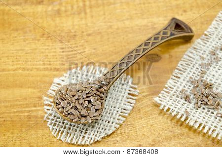 Engraved Wooden Spoon Filled With Linseeds