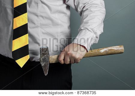 Businessman With Hammer In Hand And Working Zone Black And Yellow Stripes Cravat