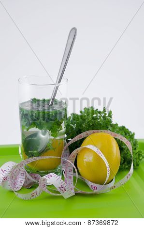 Glass Of Lemon And Parsley On A Green Tray
