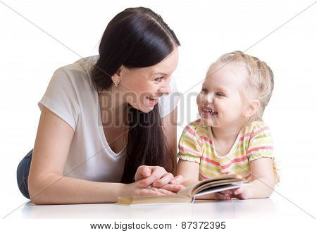 mother teaches reading book to kid