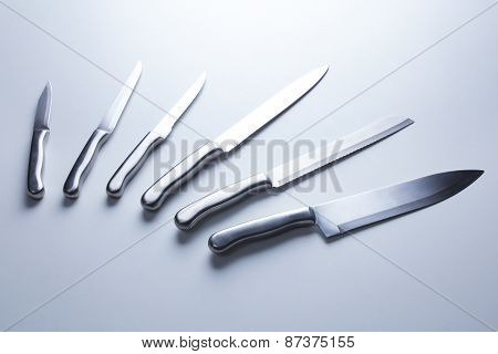 Set of steel kitchen knives, isolated