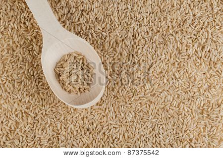 Unpolished Brown Rice Texture With Wooden Spoon