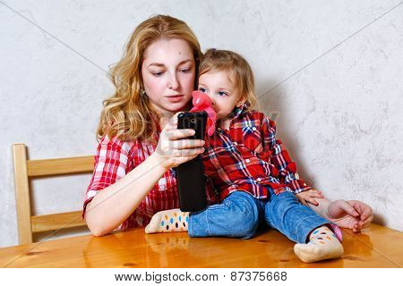 Mom Gives Daughter Drink From A Bottle