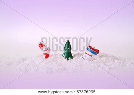 Toy Snowman Tree And Gift On Snow
