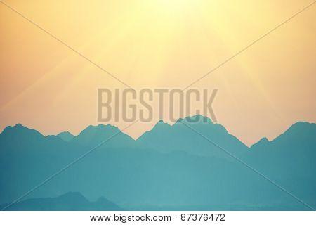 Beautiful Orange Sunset Over Mountains