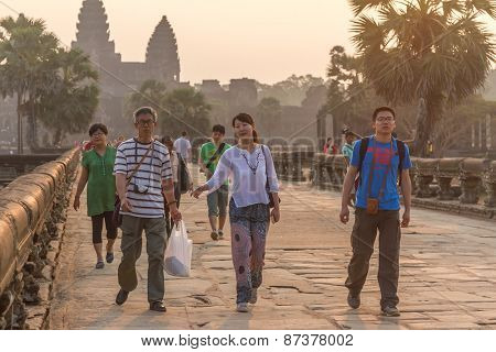 SIEM REAP, CAMBODIA - FEBRUARY 27, 2015 : Unidentified people visit the famous Angkor Wat Temple on February 27, 2015