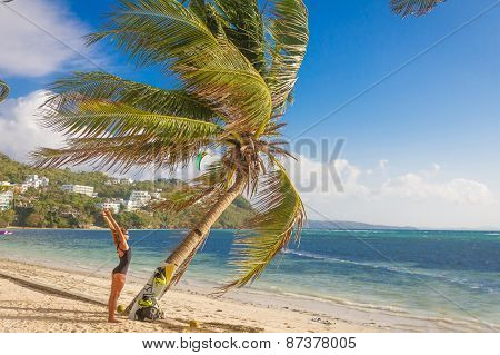 BORACAY, PHILIPPINES - March 30, 2015: Underfined female kite rider is getting ready for kite boarding on Bolabog beach, on March, 30 2015.