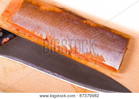 Red Fish Fillet And Knife Close-up