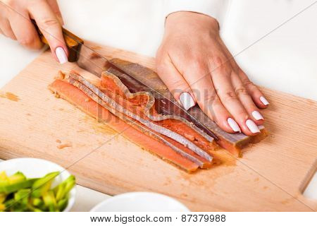 Chef Cuts The Fillet Of Red Fish Closeup