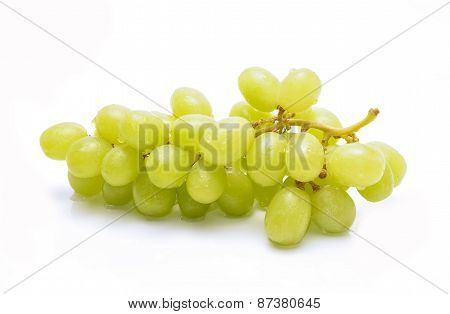 Ripe and juicy green grapes on white background