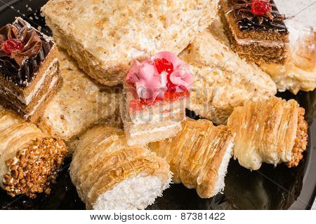 Various desserts with cream topping, coconut and powdered sugar