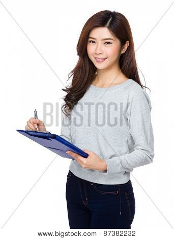 Woman write with clipboard