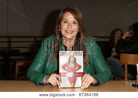 NEW YORK-APR 7: Actress Lorraine Bracco signs copies of her book 'To The Fullest' at Book Revue on April 7, 2014 in Huntington, NY.