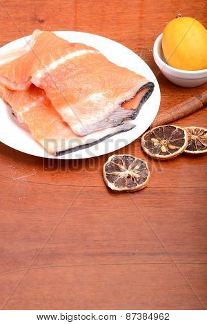 Slice Of Red Fish Salmon With Fruits And Cinnamon