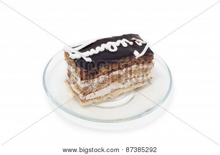 Biscuit Cake Decorated With White Cream On Plate