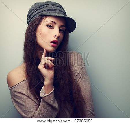 Sexy Female Model In Cap Flirting. Vintage Closeup Portrait