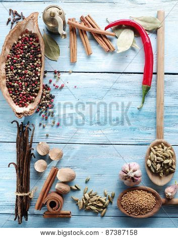 Different spices on old wooden table.