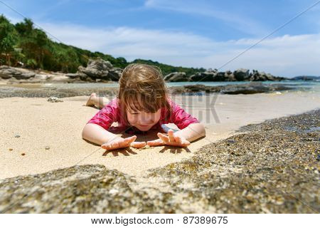 Happy child playing in sea.