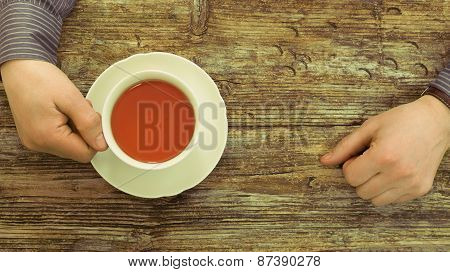 cafe table wooden male hands holding tea cup tint top view