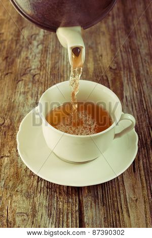 tea pour cup pot wooden table cafe instagram filter tint