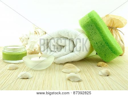 Spa And Wellness Setting With Towel, Sponge, Creme, Candles And Shells