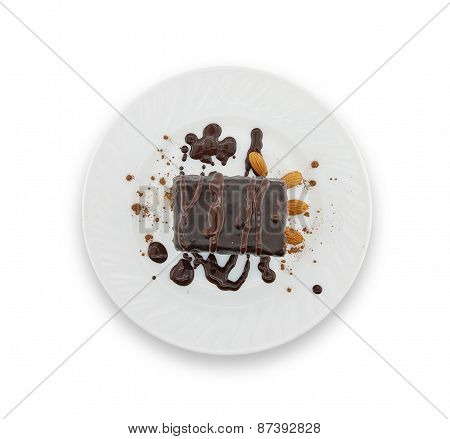 Chocolate Cake Slice With Nut On Plate, Isolated On White Background, Top View