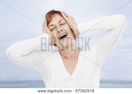 Happy senior woman on summer holiday