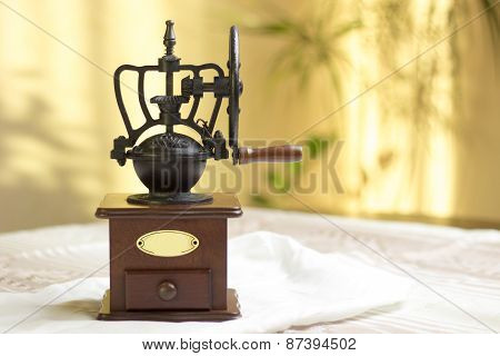 Old Coffee Grinder Filled With Coffee Beans