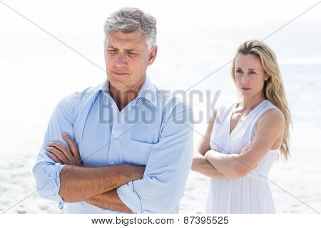 Upset couple having a disagreement at the beach